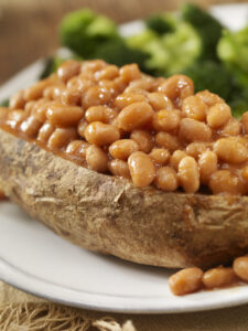 baked potato with beans and broccoli
